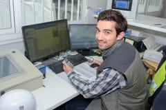 Garagist in front laptop Stock Photo