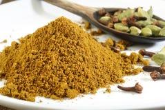 Garam masala powder. On white stock photo