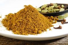Garam masala powder. On white royalty free stock image