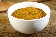 Garam masala powder. In white bowl royalty free stock image