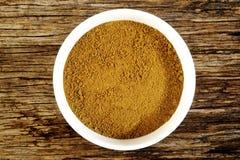 Garam masala powder. In white bowl royalty free stock images