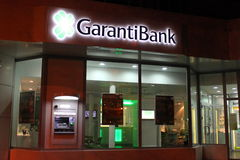 Garanti Bank. Branch In Bucharest,Romania in the night.  is a universal bank with a full range of quality and innovative products and services for all segments Royalty Free Stock Photography