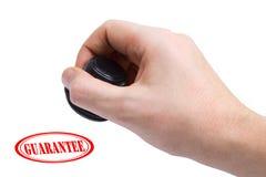 Garantia da mão e do selo Imagem de Stock