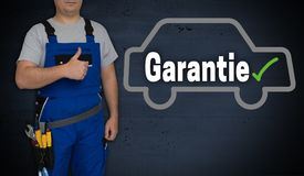 Garantie in german Guarantee car and craftsman with thumbs up.  stock photo