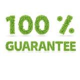 100% Garantietext von grünen Blättern Stockfotos