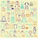 Garatujas da roupa e dos acessórios das mulheres elegantes ilustração do vetor