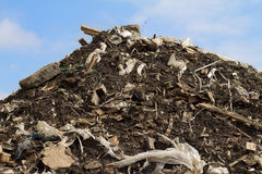 Garbage:(. The heap of garbage towers on waste ground Royalty Free Stock Image