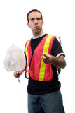 Garbage. A young worker picking up garbage and pointing at the camera, isolated against a white background Stock Image