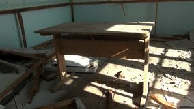 Garbage in abandoned house ghost town of Gudym Chukotka of far north of Russia. stock footage