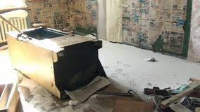Garbage in abandoned house ghost town of Gudym Chukotka of far north of Russia. stock video footage