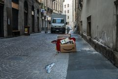 Garbage amazon on the street of milano royalty free stock photo