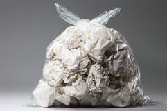 Garbage bag full of crumpled papers Royalty Free Stock Images