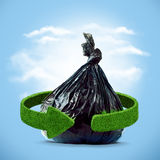 Garbage bag and green arrows from grass. Recycling concept Royalty Free Stock Photos
