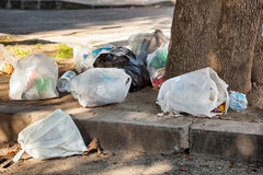Garbage bag on street Royalty Free Stock Images
