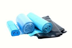 Garbage bags. Blue refuse bags in rolls on a white background Stock Photo