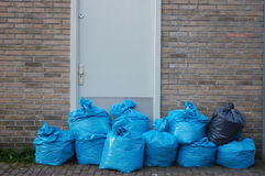 Garbage bags. Some blue garbage bags in a row Royalty Free Stock Photo