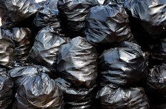 Garbage bags. A pile of black plastic garbage bags Royalty Free Stock Photography