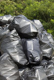 Garbage bags. Black trash bags in the nature Stock Photography