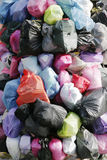 Garbage Bags. Many Garbage Plastic Bags With Different Colours Piled Up royalty free stock image