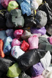 Garbage Bags. Many Garbage Plastic Bags With Different Colours Piled Up stock image