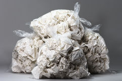 Garbage bags full of crumpled papers Stock Image