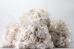 Garbage bags full of crumpled papers Stock Photography