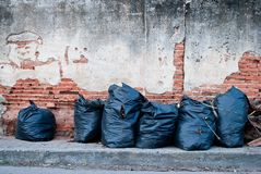 Garbage bags. On the old walls Stock Photo