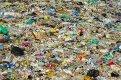 Garbage bags and plastic bottles at the city dump royalty free stock photo