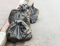 The garbage bags on road. Royalty Free Stock Image
