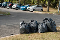 Garbage bags on roadside Royalty Free Stock Photos