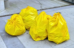 Garbage bags on the street Royalty Free Stock Images