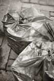 Garbage bags on the street. Recycle rubbish. Clean environment. Vertical Stock Photo