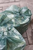Garbage bags on the street. Recycle rubbish. Clean environment. Vertical Royalty Free Stock Photos