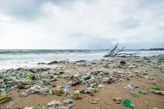 Garbage on beach, environmental pollution in Bali Indonesia. Drops of water are on camera lens. Dramatic view stock photos