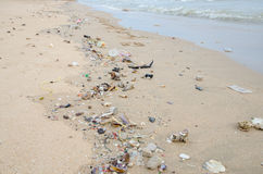 Garbage on a beach, environmental pollution Stock Image