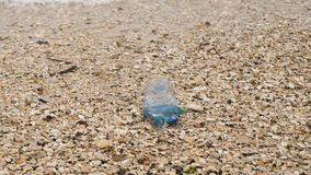 Garbage at beach: Plastic bottle. 4K UHD stock video