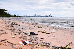 Garbage on the  beach in thailand Stock Photos