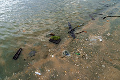Garbage beach Stock Images