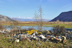 Garbage in beautiful natural landscape Royalty Free Stock Photos