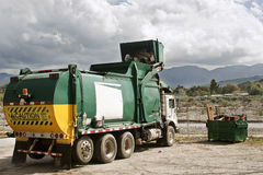 Garbage being Dump. Garbage truck caught in action disposing trash Royalty Free Stock Images