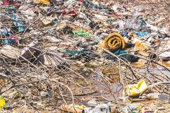 Big pile of garbage and junk in the river water polluting the nature with litter. Garbage. Big pile of garbage and junk in the river water polluting the nature Royalty Free Stock Photos