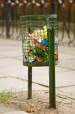 Garbage bin. Full of garbage in park Royalty Free Stock Photo