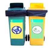 Garbage Bin. Green and yellow garbage bin on White Background royalty free stock photos