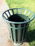 Garbage bin. A green empty garbage bin at the park Stock Photos