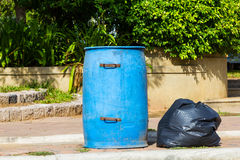 Garbage bin and black bag Royalty Free Stock Photo