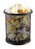 Garbage bin with crumpled paper Stock Images