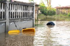 Garbage bin float. Flooding in town. stock photo