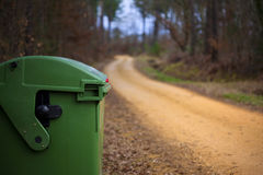 Garbage bin in a forest Stock Photos