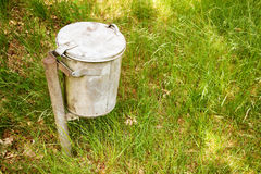 Garbage bin in the grass Royalty Free Stock Images
