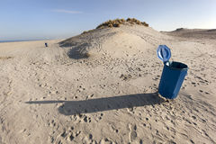 Garbage bin near the dunes Stock Images